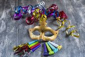 foto of blowers  - Carnival mask with colorful streamers and party blowers - JPG