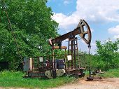 pic of oil well  - Old oil pump jack on the oil well - JPG