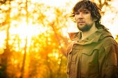 picture of survival  - Young Man standing alone in forest outdoor with sunset nature on background Travel Lifestyle and survival concept - JPG