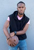 pic of swagger  - Portrait of a cool young african american guy holding basketball - JPG