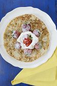 pic of tuesday  - Shrove Pancake Tuesday pancakes with strawberries and cream on dark blue vintage shabby chic table vertical - JPG