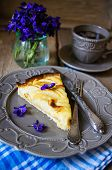 pic of helleborus  - French apple tart on the old rustic table with flowers and napkin - JPG
