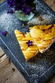 picture of helleborus  - French apple tart on the old rustic table with flowers and napkin - JPG
