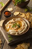 foto of dipping  - Healthy Homemade Creamy Hummus with Olive Oil and Pita Chips - JPG