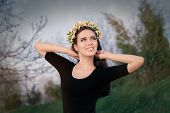 stock photo of headdress  - Portrait of a beautiful young woman outside wearing a floral headdress - JPG