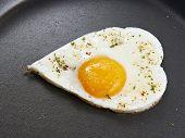 picture of yoke  - Fried eggs in heart form for breakfast - JPG