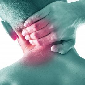 stock photo of cubit  - Studio shot of sportsman with pain in neck - JPG