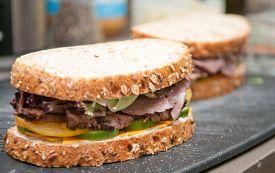 stock photo of deli  - roast beef deli style sandwich on cracked whole wheat bread - JPG