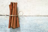 stock photo of cinnamon sticks  - Some cinnamon sticks tied with a natural rope - JPG
