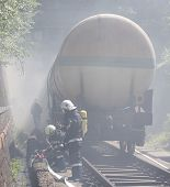 stock photo of dangerous situation  - Oil tanker train is seen in smoke near Sofia Bulgaria - JPG