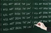 pic of punishment  - I will not break the law sentence written repeatedly on blackboard as a punishment - JPG