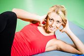 image of crunch  - Young woman exercising in gym - JPG