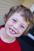 picture of toothless smile  - adorable little boy showing off his lost front tooth - JPG