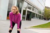 pic of breathing exercise  - young woman catching her breath while out running - JPG