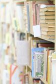 stock photo of hardcover book  - The image of books on the shelf in a library - JPG