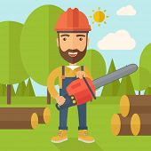foto of man chainsaw  - Lumberjack with hard hat as protection cuts a tree by chainsaw under the heat of the sun - JPG