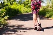 picture of ankle shoes  - Beautiful female legs in pink shoes are on the road - JPG