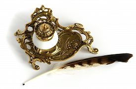 image of inkwells  - Photo shows Ornate antique brass inkwell with feather - JPG