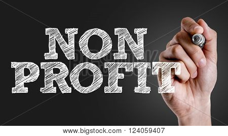 Hand writing the text: Non Profit