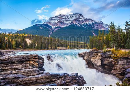 Powerful picturesque waterfall Athabasca Pyramidal