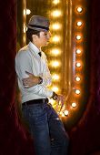 pic of peddlers  - young man with glass of wine near the mirror in cabaret - JPG