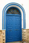 foto of asilah  - blue door and arch in the medina district of asilah in morocco - JPG