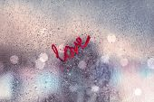 All you need is love, strong message of love, urban window covered with raindrops, romantic relation poster
