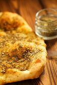 Zaatar spice mix with naan bread - traditional Middle Eastern blend made with thyme, sesame seeds, s poster