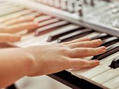 Midi keyboard or electronic piano and playing child hands. Musical education for kid in music school poster