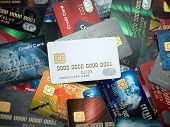 White blank credit cards mockup onthe background of colorful credit cards of the different banks. 3d poster