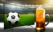 Football match from the stadium. TV broadcast of the match. Fans like to drink beer when watching a  poster