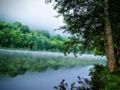 Moselle River Reflecting Trees Of Water Sunset Near Toul France Campground With Mist On The River Wi poster