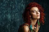 Beautiful bright woman with curly foxy hair wears a beads and earrings in boho style. Ethnic style i poster