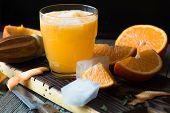 Glass Of Fresh Orange Juice,ripe Orange Fruit And Slices On Rustic Wooden Table.freshly  Orange Juic poster