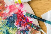 fine art, creativity and artistic tools concept - close up of palette knife or painting spatula and  poster