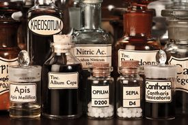 stock photo of belladonna  - Various pharmacy bottles of homeopathic medicine on dark background - JPG