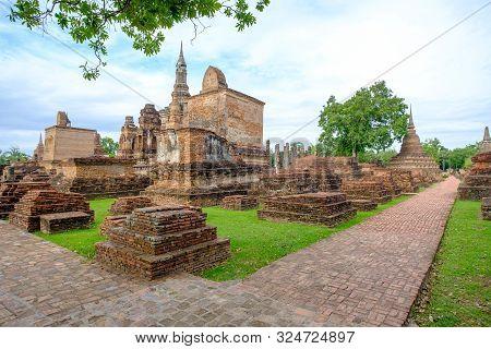 poster of Sukhothai Historical Park, Temple Ruins Of Wat Mahathat In The Sukhothai Historical Park, Thailand.