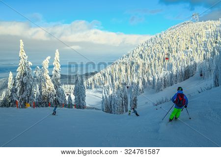 poster of Admirable Snow Covered Trees And Winter Ski Resort With Fast Cable Cars, Gondolas. Active Sporty Ski