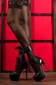 Legs Of A Woman In Fetish Wear: Stockings, Handcuffs And High Heels Boots With Extrem Platform Near  poster