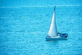 Sailing Yacht In The Blue Calm Sea. A Yacht In Peaceful Waters. poster