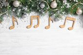 Flat Lay Composition With Christmas Decor And Music Notes On White Wooden Table, Space For Text poster