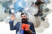 Happy Birthday Guy Holds Helium Balloons And Gift Box. Festive Event Or Birthday Party. Handsome Man poster