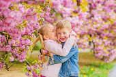 Little Girl Enjoy Spring Flowers. Giving All Flowers To Her. Surprising Her. Kids Enjoying Pink Cher poster
