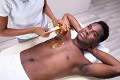Person Hands Waxing Mans Chest poster