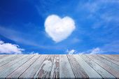 Pastel Wood Planks Old Texture Foreground With A White Cloud In The Shape Of A Heart In The Blue Sky poster