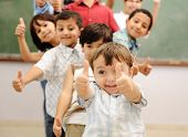 foto of middle finger  - Children at school classroom - JPG