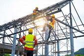 Engineer Technician Watching Team Of Workers On High Steel Platform,engineer Technician Looking Up A poster