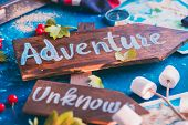 Road Sign With Adventure And Unknown Directions. Travel Essentials Creative Header With Socks, Maps, poster