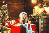 Family Holiday. Happy Family. Mom And Kid Play Together Christmas Eve. My Dear Baby Santa. Mother An poster