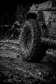 Off Road Sport Truck Between Mountains Landscape. Mudding Is Off-roading Through An Area Of Wet Mud  poster